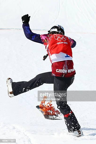 Eva Samkova of the Czech Republic kicks her snowboard as she celebrates winning the the Ladies' Snowboard Cross Finals on day nine of the Sochi 2014...
