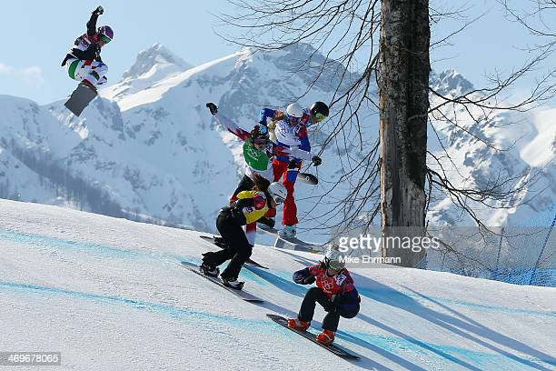 Eva Samkova of the Czech Republic leads the group during the Ladies' Snowboard Cross Final on day nine of the Sochi 2014 Winter Olympics at Rosa...