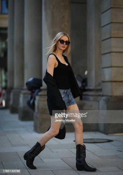 Eva Staudinger wearing other stories body and blazer Agolde jeans shorts vintage cowboy boots on July 31 2020 in Hamburg Germany