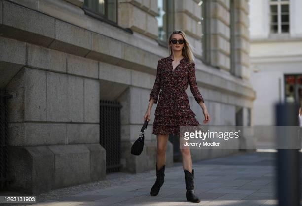 Eva Staudinger wearing SET Fashion dress and vintage cowboy boots on July 31 2020 in Hamburg Germany