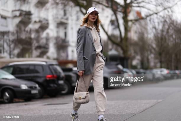 Eva Staudinger wearing SoSue jogging suit, white cap, New Balance sneaker and Boss blazer on January 14, 2021 in Hamburg, Germany.