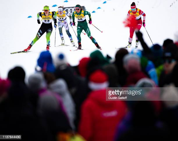 Eva Urevc of Slovenia Greta Laurent of Italy and Ebba Andersson of Sweden compete in the sprint quarterfinal heat during the FIS Cross Country Ski...
