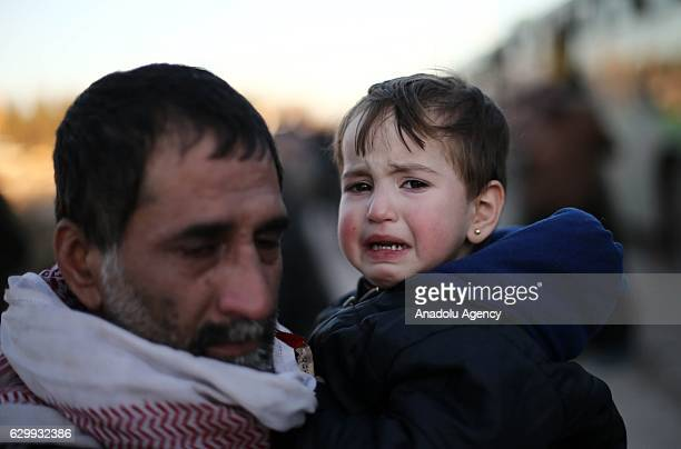 Evacuated civilians fled from East Aleppo had been under siege by Iranled Shiite militias and Assad Regime forces arrive at a checkpoint in rural...