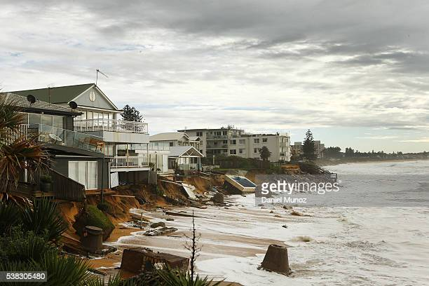 Evacuated houses are hit by big waves after torrential rains at Collaroy beach on June 6 2016 in Sydney Australia Torrential rain over the weekend...