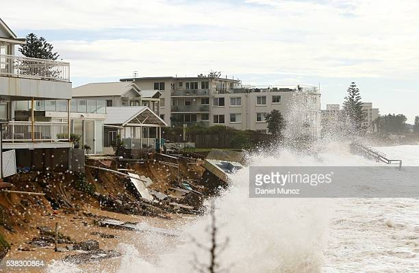 Evacuated houses are hit by big waves after torrential rains on June 6 2016 in Sydney Australia Torrential rain over the weekend saw streets and...