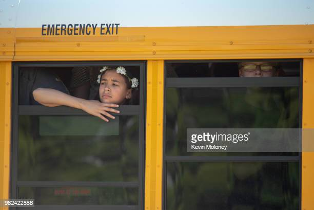 Evacuated middle school students wait on a bus outside Noblesville High School after a shooting at Noblesville West Middle School on May 25 2018 in...