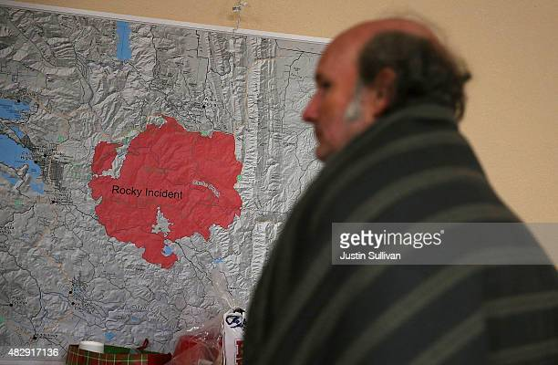 Evacuated resident Daniel Myers looks at a map of the Rocky Fire at the Moose Lodge where several dozen evacuees are staying on August 4 2015 in...