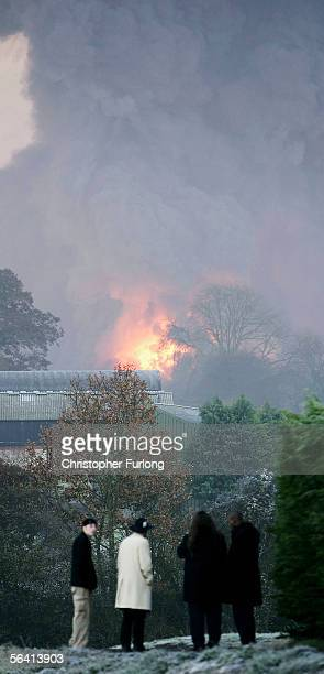 Evacuated residents look as plumes of smoke rise from Bruncefield oil depot on December 11 2005 in Hemel Hempstead EnglandThe explosions are being...