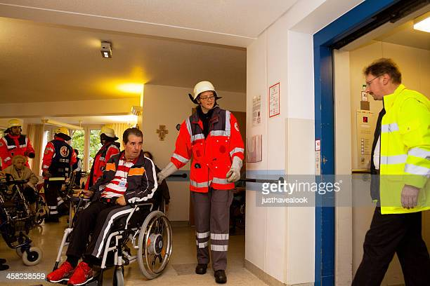 evacuation of nursed seniors by red cross - evacuation stock pictures, royalty-free photos & images