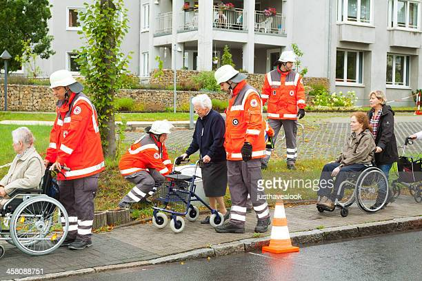 evacuation of nursing home - evacuation stock pictures, royalty-free photos & images