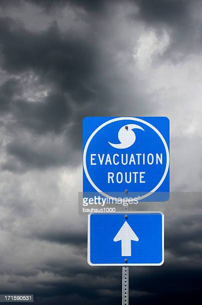 evacuation route road sign - evacuation stock pictures, royalty-free photos & images