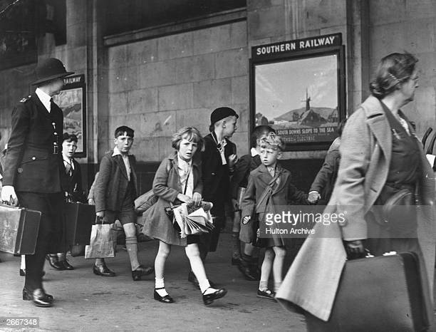 Evacuee children on their way out of London