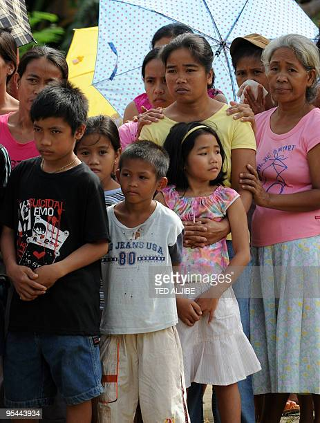 Evacuees affected by Mayon volcano wait for relief goods distribution at an evacuation center in Santo Domingo town Albay province 330 kilometres...