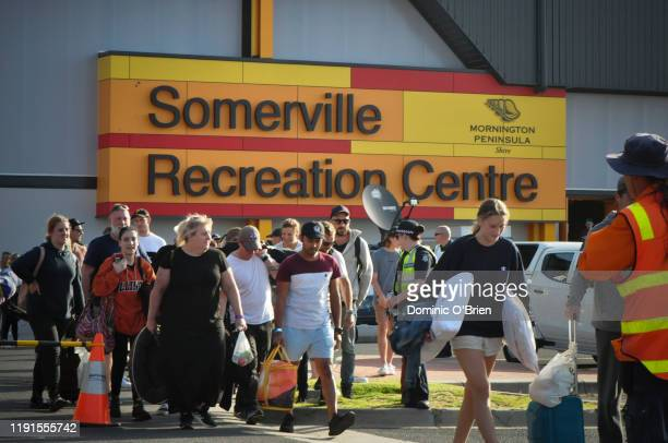 Evacuees arrive at the Somerville relief center on January 4 2020 in Somerville Australia HMAS Choules was deployed to help evacuate thousands of...
