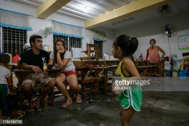 Evacuees displaced following the eruption of the Taal volcano rest in a classroom of the Bernado Lirio Memorial High School in Tanauan on Janaury 17...