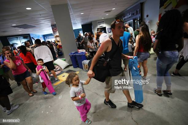 Evacuees enter the Germain Arena that is serving as a shelter from the approaching Hurricane Irma on September 9 2017 in Estero Florida Current...