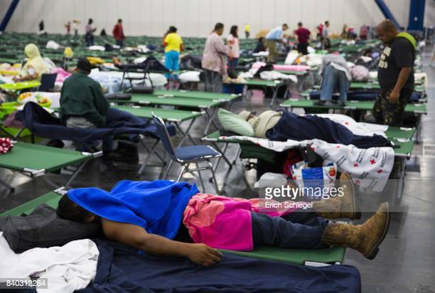 Evacuees fill up cots at the George Brown Convention Center that has been turned into a shelter run by the American Red Cross to house victims of the...
