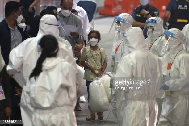 Evacuees from Afghanistan arrive at Incheon International Airport on August 26, 2021 in Incheon, South Korea. A total of 378 Afghans arrived in South...