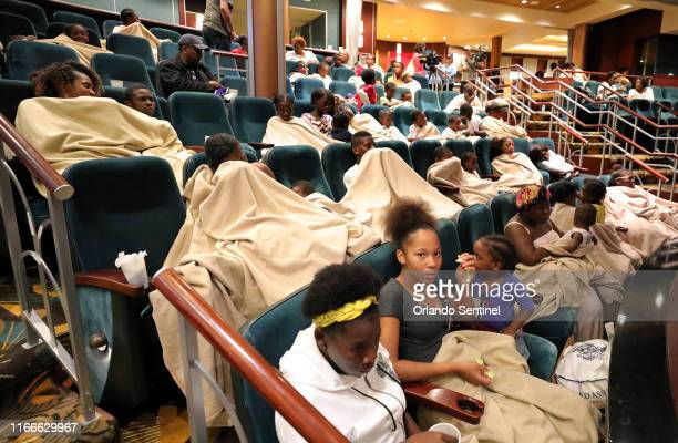 Evacuees from Freeport Bahamas rest onboard the Royal Caribbean's Mariner of the Seas cruise ship after it arrived in Freeport on Saturday Sept 7 2019