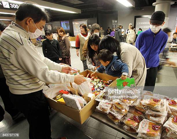 Evacuees from Fukushima prefecture receive necessaries including food at Saitama Super Arena in Saitama City Japan on Monday March 21 2011 Photo by...