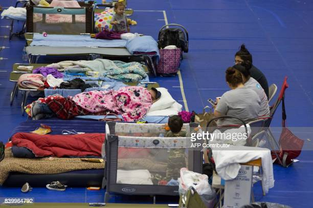 Evacuees from Hurricane Harvey take shelter at the Delco Center in east Austin Texas on Sunday August 27 2017 The Red Cross says they currently have...