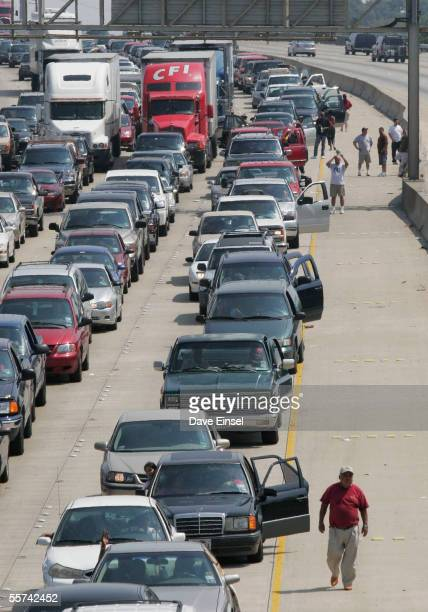 Evacuees from Hurricane Rita stand outside their vehicles on Interstate 10 near downtown Houston Thursday September 22 2005 Traffic was at a...