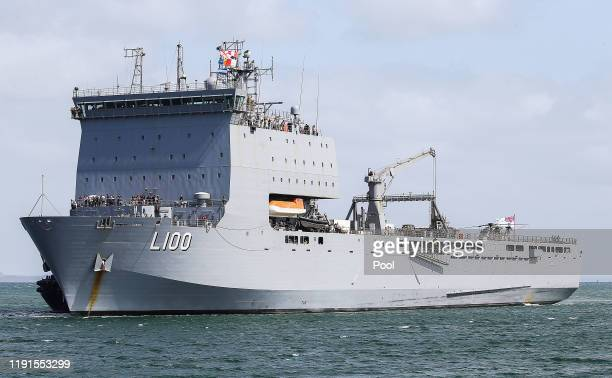 Evacuees from Mallacoota arrive aboard the HMAS Choules on January 4 2020 at the port of Hastings Australia The Australian Navy deployed rescue ships...