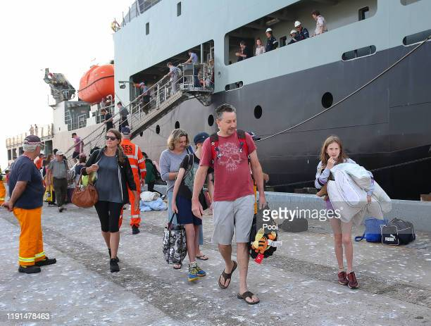 Evacuees from Mallacoota arrive aboard the navy ship MV Sycamore on January 4 2020 at the port of Hastings Australia The Australian Navy deployed...