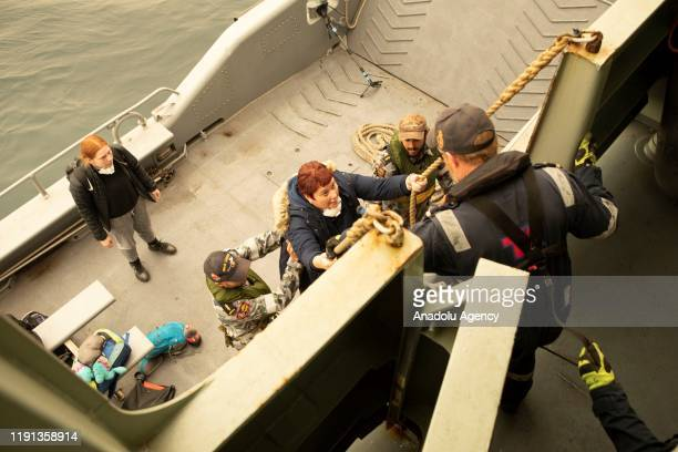 Evacuees from Mallacoota board MV Sycamore in Victoria Australia on January 3 2020 The Australian Defence Force commenced has commenced Operation...
