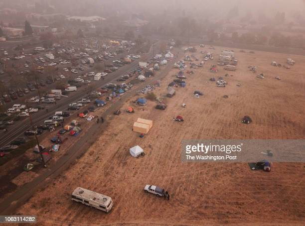 Evacuees from the Camp Fire shelter in tents outside the Walmart on November 16 2018 in Chico Ca Most of Paradise California has been destroyed by...