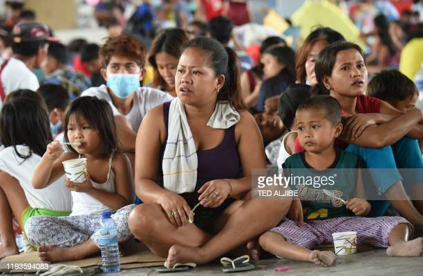 Evacuees from towns affected by the eruption of Taal volcano rest at an evacuation center in Tanauan town Batangas province south of Manila on...