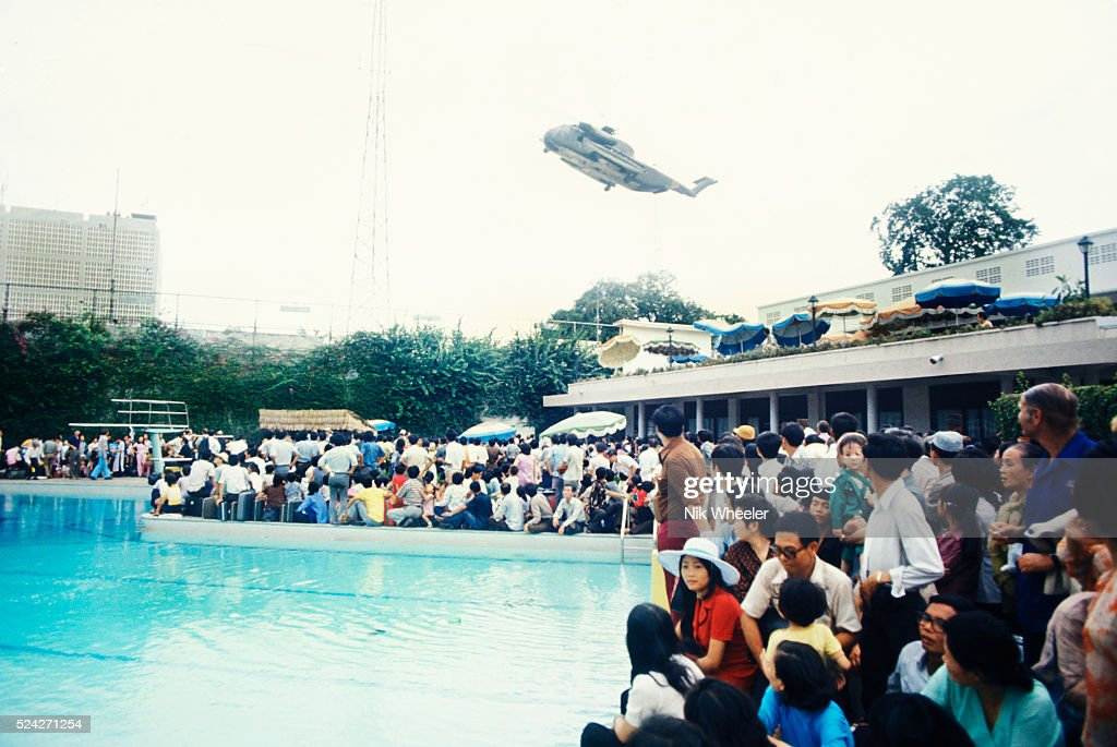 Crowded swimming pool at US Embassy, Fall of Saigon 1975 : News Photo