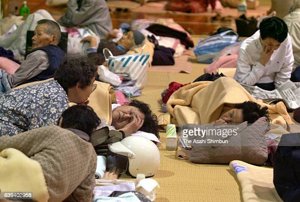 Evacuees lie on the floor at Hino Junior High School where they take shelter a day after the Magnitude 7.3 earthquake hit western Tottori on October...