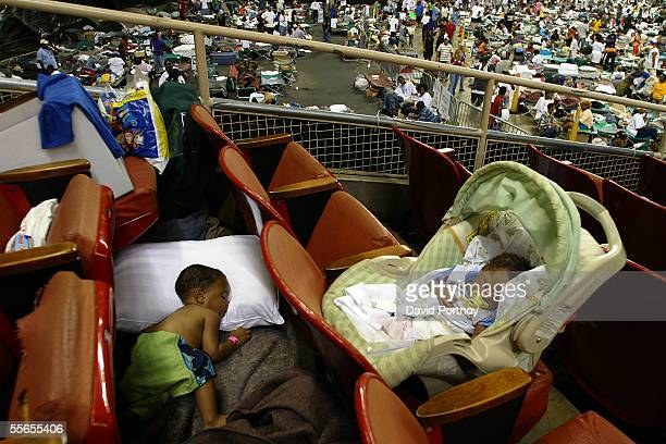 Evacuees of Hurricane Katrina Issac Williams sixteen months and his sister Ikea Williams 2 weeks sleep on the floor and seats of the Astrodome in...