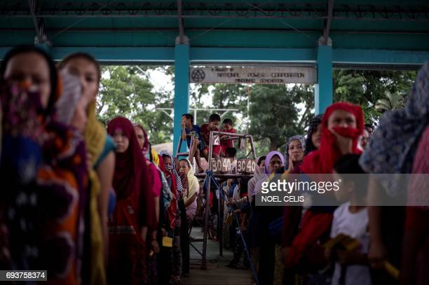 Evacuees queue for relief goods distributed at an covered basketball court used as an evacuation centre in Baloi Iligan on the southern Philippine...