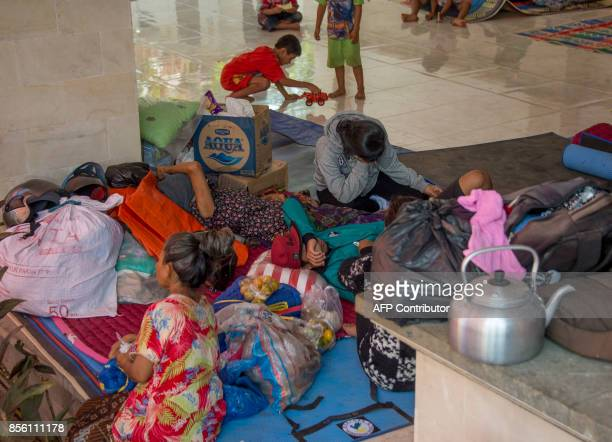 Evacuees relax at an evacuation shelter in Tembok Buleleng Regency on the Indonesian resort island of Bali on October 1 2017 Mount Agung 75...