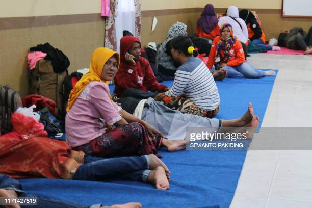 Evacuees rest at a military base in Wamena, Papua, on September 27 as they wait for their turn to leave the city by a military Hercules aircraft. -...