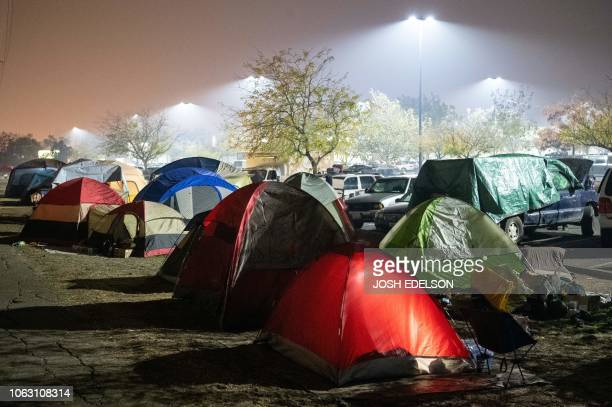 TOPSHOT Evacuees rest in their tents for the night in a Walmart parking lot in Chico California on November 17 2018 More than 1000 people remain...
