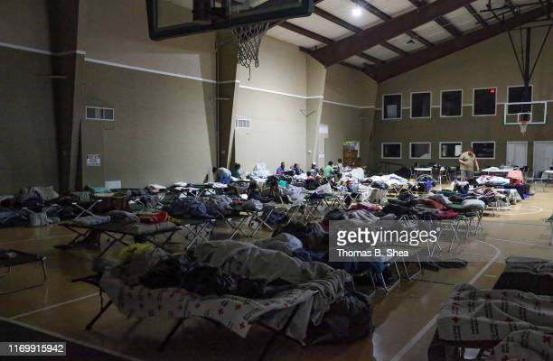 Evacuees rest inside the gymnasium of First Bapist Church in Hampshire on highway 124 on September 20 2019 in Beaumont Texas Over 300 evacuees spend...