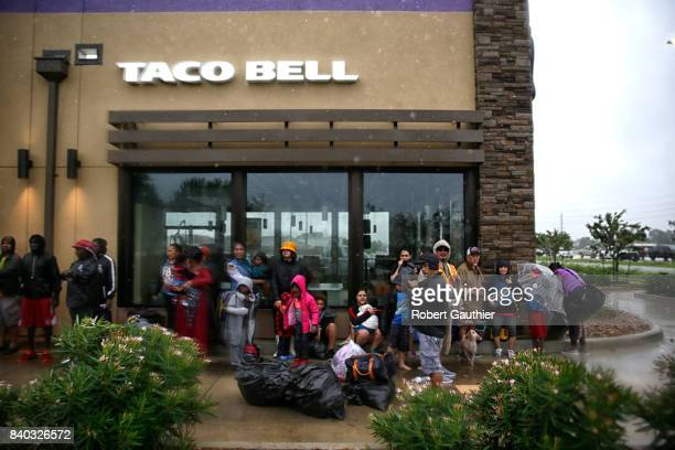 Evacuees seek shelter at their neighborhood Taco Bell after being rescued from rising flood waters in Clodine