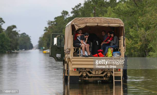 Evacuees sit in the back of a rescue truck on highway 124 on September 20 2019 in Beaumont Texas Gov Greg Abbott has declared much of Southeast Texas...