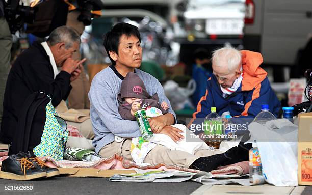 Evacuees spend time at an evacuation center on April 16 2016 in Mashiki Kumamoto Japan The magnitude 73 earthquake hit Kyushu just after the...