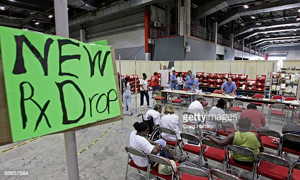 Evacuees wait for their prescriptions to be filled as CVS Pharmacy sets up 24 hour service for evacuees from New Orleans at Reliant Arena on...