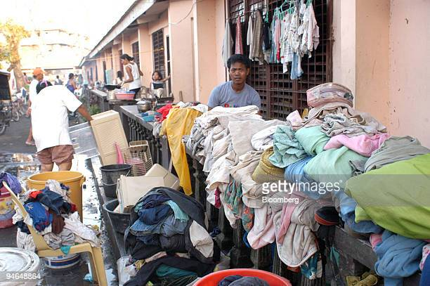 Evacuees wash their clothes Tuesday December 5 in Binitayan village Daraga Town in Albay Philippines after their houses were devastated by flooding...