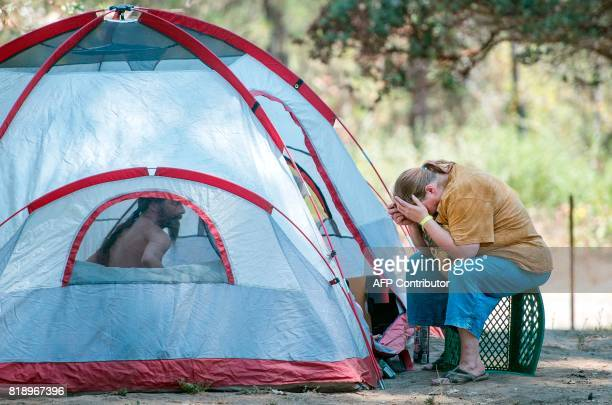 Evacuees who declined to give their names react to their situation while camping at a Red Cross evacuation center in Oakhurst California on July 19...