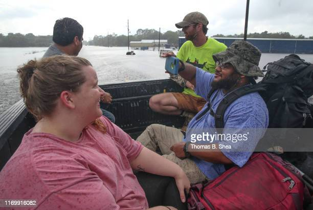 Evacuees who were housed in the First Baptist Church in Hamshire are moved by the Cajun Army to Fannett on highway 124 on September 20 2019 in...