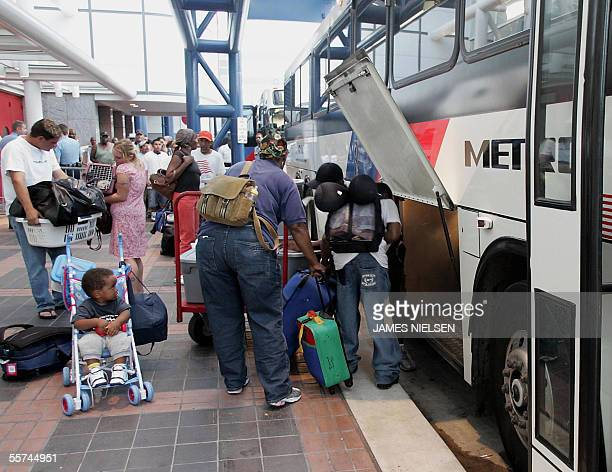 Evacuees with special medical needs load their luggage on buses at George R Brown Convention Center before hurricane Rita in Houston Texas 22...