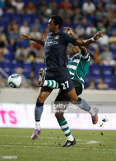 Evaldo Fabiano of Sporting Lisbon battles for the ball against Jo Silva of Manchester City on July 23 2010 at Red Bull Arena in Harrison New Jersey...