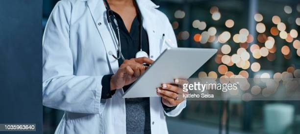 evaluating healthcare reports - medical stock photos and pictures