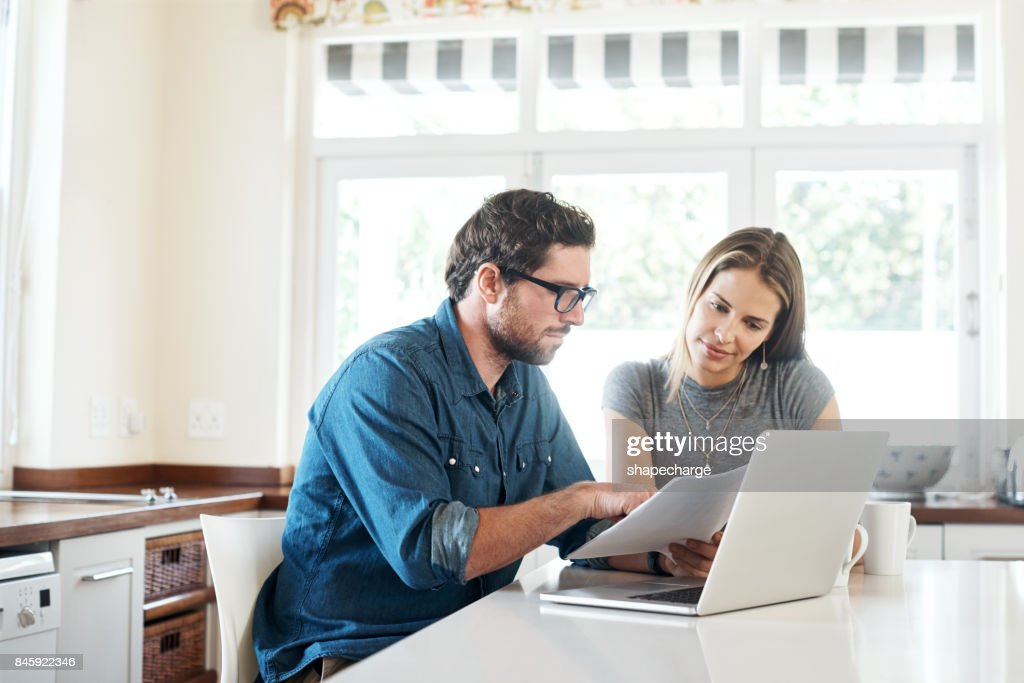 Evaluating their income and expenditure : Stock Photo